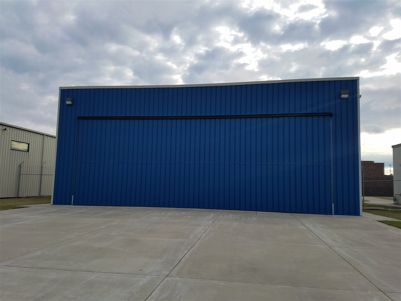 50 ft wide bi-fold hangar door with remote control. Apron is heated for snow melting (controllable).