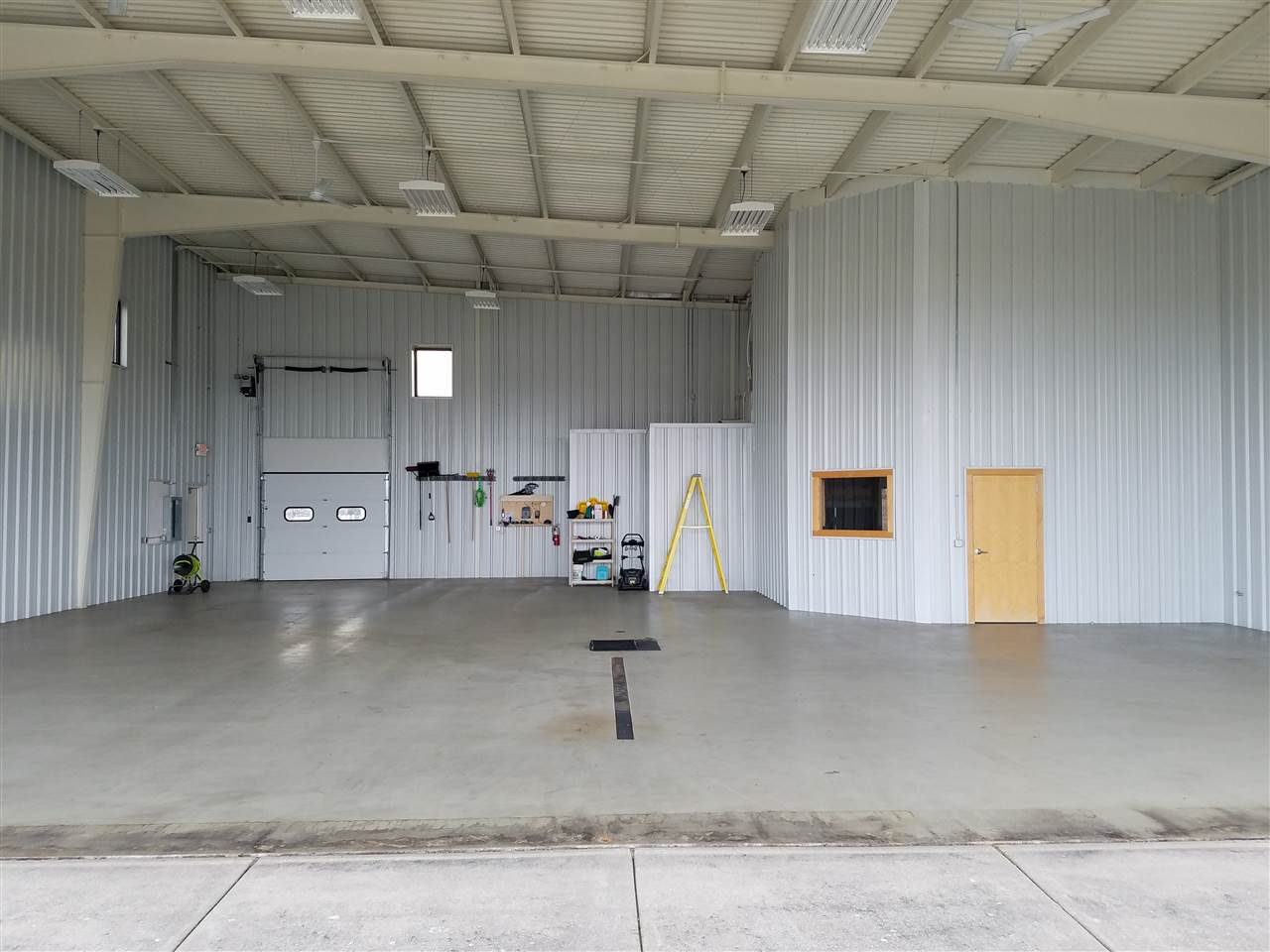 Inside hangar with in-floor heating and office air conditioning. Epoxy coated floor for wash-down and snow melting.